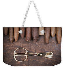 Weekender Tote Bag featuring the photograph Gold Cigar Cutter  by Andrey  Godyaykin