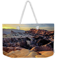 Weekender Tote Bag featuring the photograph Golden Hour Light On Zabriskie Point by John Hight