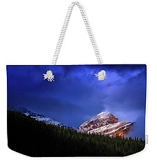 Weekender Tote Bag featuring the photograph Golden Nugget by John Poon