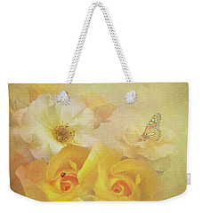 Weekender Tote Bag featuring the photograph Golden Showers Yellow Roses by Diane Schuster