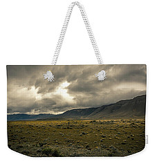 Weekender Tote Bag featuring the photograph Golden Storm by Andrew Matwijec