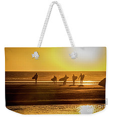 Weekender Tote Bag featuring the photograph Golden Surfers by Mitch Shindelbower
