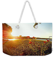 Weekender Tote Bag featuring the photograph Goldenhour Flowers by Nikki McInnes