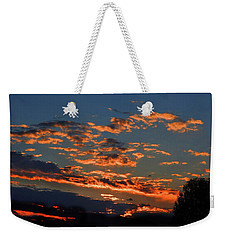 Weekender Tote Bag featuring the photograph Goldflake Sunset by Mark Blauhoefer
