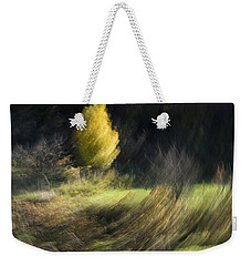 Weekender Tote Bag featuring the photograph Gone With The Wind by Raffaella Lunelli