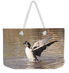 Weekender Tote Bag featuring the photograph Goose Flapping Wings by Wendy Coulson