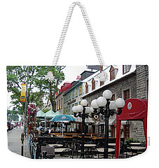 Weekender Tote Bag featuring the photograph Grande Allee Est by John Schneider