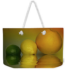 Weekender Tote Bag featuring the photograph Grapefruit Lemon And Lime Citrus Fruit by David French