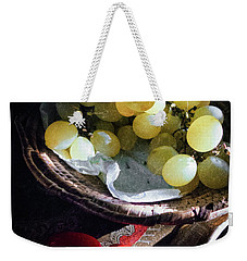 Weekender Tote Bag featuring the photograph Grapes And Tomatoes by Silvia Ganora