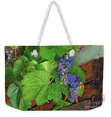Weekender Tote Bag featuring the photograph Grapes by John Kolenberg