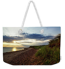 Weekender Tote Bag featuring the photograph Grass Sways On Prince Edward Island Bluffs by Chris Bordeleau