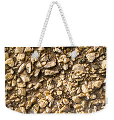 Weekender Tote Bag featuring the photograph Gravel Stones On A Wall by John Williams