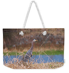 Weekender Tote Bag featuring the photograph Great Blue Heron By The River by Sharon Talson