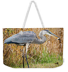 Great Blue Heron Struggling With Lunch Weekender Tote Bag by Ricky L Jones