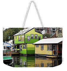 Weekender Tote Bag featuring the photograph Green And Yellow Houses by Haleh Mahbod