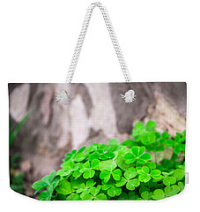 Weekender Tote Bag featuring the photograph Green Clover And Grey Tree by John Williams