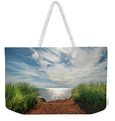 Weekender Tote Bag featuring the photograph Green Grass And Red Sand by Chris Bordeleau