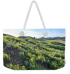 Weekender Tote Bag featuring the photograph Green Hills Purple Flowers - Rocky View by Matt Harang