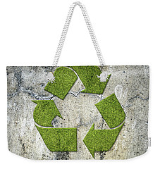 Green Recycling Sign On A Concrete Wall Weekender Tote Bag by GoodMood Art
