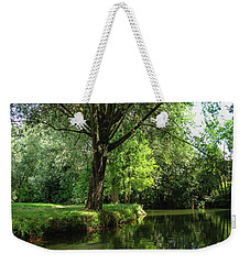 Weekender Tote Bag featuring the photograph Green Reflections by Cristina Stefan