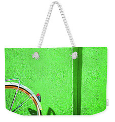 Weekender Tote Bag featuring the photograph Green Wall And Bicycle Wheel by Silvia Ganora