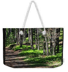 Weekender Tote Bag featuring the photograph Green Wood by Raffaella Lunelli
