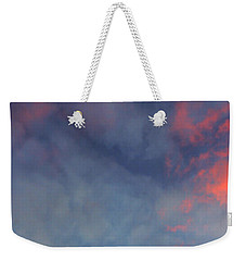 Weekender Tote Bag featuring the photograph Pink Flecked Sky by Linda Hollis