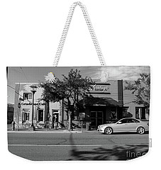 Weekender Tote Bag featuring the photograph Grindstone Cafe by Mark Alan Perry