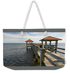 Weekender Tote Bag featuring the photograph Gulf Coast Pier by Ron Sadlier