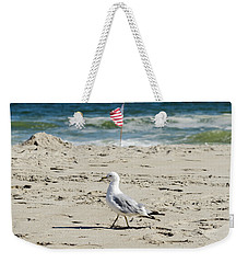 Weekender Tote Bag featuring the photograph Gull And Flag Rockaway Beach by Maureen E Ritter