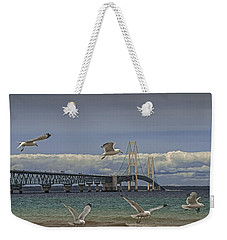 Gulls Flying By The Bridge At The Straits Of Mackinac Weekender Tote Bag by Randall Nyhof