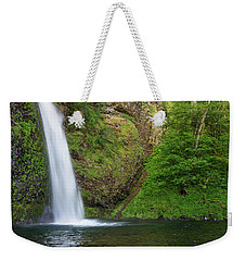 Weekender Tote Bag featuring the photograph Gushing Horsetail Falls by Greg Nyquist