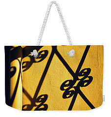 Weekender Tote Bag featuring the photograph Gutter And Ornate Shadows by Silvia Ganora