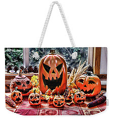 Weekender Tote Bag featuring the photograph Halloween Display by Wendy McKennon