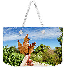 Hand Holding A Beautiful Oak Leaf Weekender Tote Bag