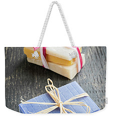 Weekender Tote Bag featuring the photograph Handmade Soaps by Elena Elisseeva