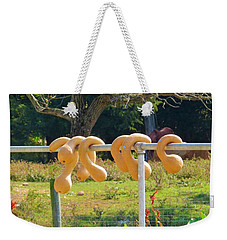 Weekender Tote Bag featuring the photograph Hang In There by Jeanette Oberholtzer