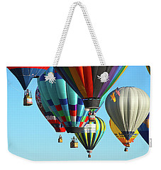 Weekender Tote Bag featuring the photograph Hanging Around by Marie Leslie