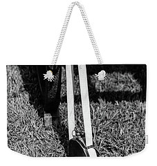 Weekender Tote Bag featuring the photograph Hanging Canteen by Doug Camara