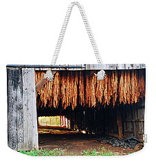 Weekender Tote Bag featuring the photograph Hanging Tobacco by James Kirkikis