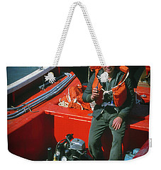 Weekender Tote Bag featuring the photograph Happy Sailor In Orange Lifeboat by Samuel M Purvis III