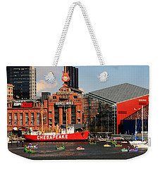 Weekender Tote Bag featuring the photograph Harbor Fun by Karen Harrison