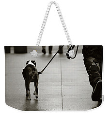 Weekender Tote Bag featuring the photograph Hauling Ass by Empty Wall