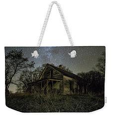 Weekender Tote Bag featuring the photograph Haunted Memories by Aaron J Groen