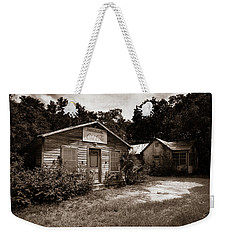 Weekender Tote Bag featuring the photograph Hazel's Cafe by Chris Bordeleau