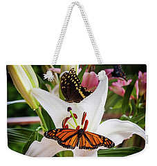 Weekender Tote Bag featuring the photograph He Still Gives Me Butterflies by Karen Wiles