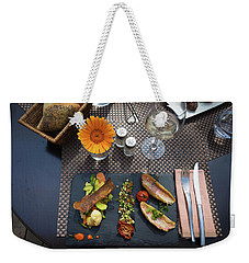 Weekender Tote Bag featuring the photograph Health Fish Dish Served At A French Restaurant by Semmick Photo
