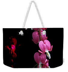 Weekender Tote Bag featuring the photograph Hearts In The Dark by Susan Capuano