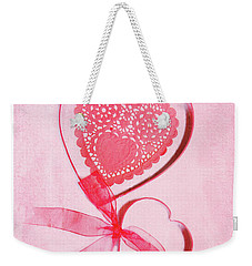 Weekender Tote Bag featuring the photograph Hearts by Rebecca Cozart