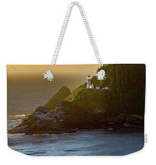 Weekender Tote Bag featuring the photograph Heceta Head Lighthouse At Sunset by John Hight